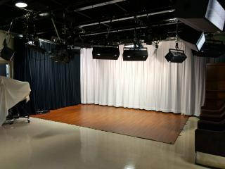 View of NCAT studio with curtain backdrops and professional lighting equipment